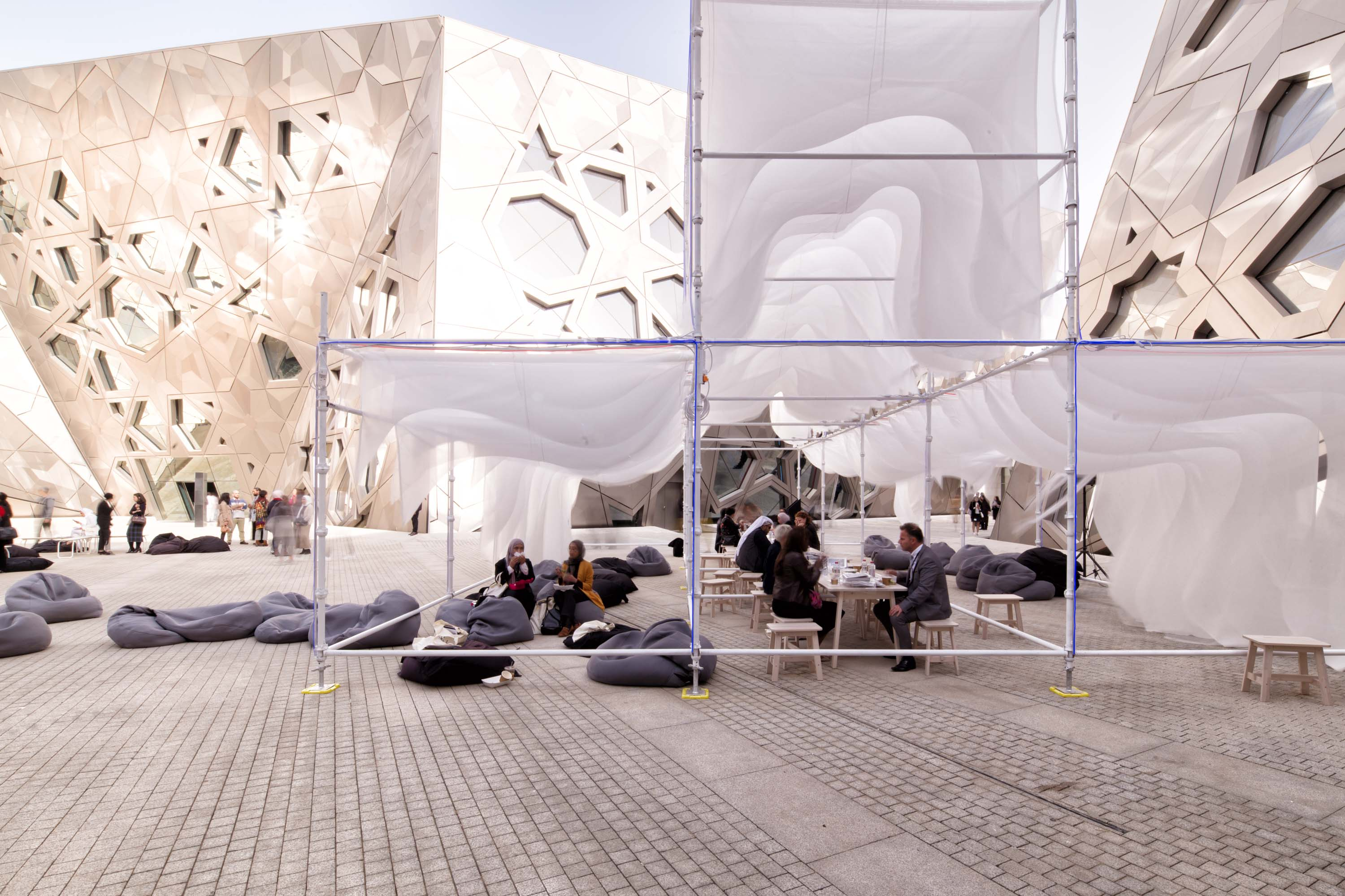 LUMINOUS DRAPES, a modular pavilion made from scaffolding